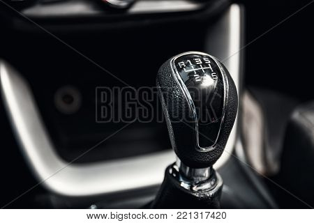 close up of gear shift in new modern car interior