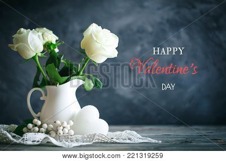 Valentines day card. Mother's day. Womans day. Still life with white roses on a wooden table. Selective focus