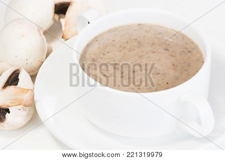 Mushroom soup with fresh white button mushroom close up
