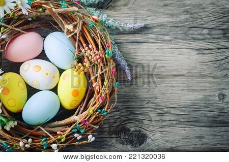 Happy Easter. Congratulatory easter background. Easter eggs and flowers. Background with copy space.