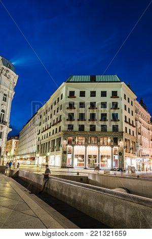 Vienna,  Austria - August 16, 2017: Street scene at night in Vienna in Michaelerplatz with Looshaus designed by Adolf Loos on background