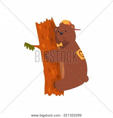 Smiling wild bear hugging tree trunk. Cartoon animal character with brown fur, small rounded ears and paws with claws. Grizzly in orange cap and bow tie. Flat vector design for sticker, postcard, book