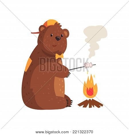 Cartoon bear frying marshmallow on fire in woods. Adorable grizzly character in orange cap and bow tie. Wild animal with brown fur, small rounded ears and paws with claws. Isolated flat vector design.