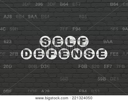 Protection concept: Painted white text Self Defense on Black Brick wall background with Hexadecimal Code