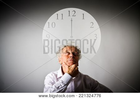 Old man in white is full of doubts and hesitation. Twelve o'clock. Time is passing.