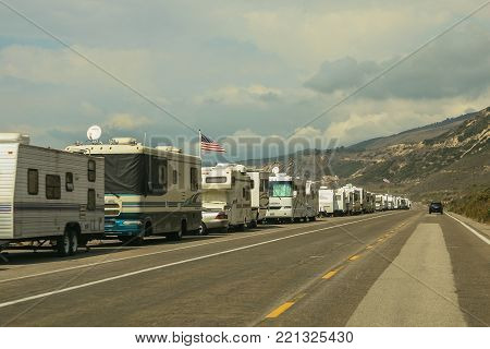 VENTURA COUNTY, CALIFORNIA, USA - OCTOBER 06, 2006. Several recreational vehicules are parked along the roadside in Faria Beach National Park, in Ventura County, California.