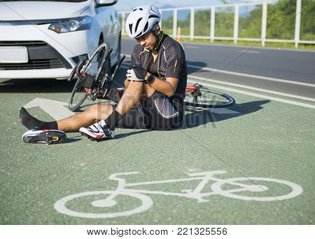 Asia cyclist injured on the street bike after collision accident car and bike.