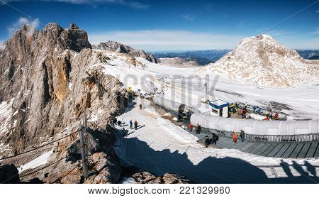 Dachstein, Austria - October 2, 2017: Panoramic aerial view of slopes of Dachstein plateau ski resort with glacier and mountains. Austria