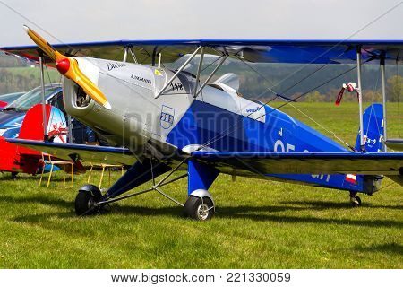 PLASY, CZECH REPUBLIC - APRIL 30: Biplane Bucker Bu-131 Jungmann produced under licence as Tatra T-131 PA on airport runway on April 30, 2017 in Plasy, Czech Republic.