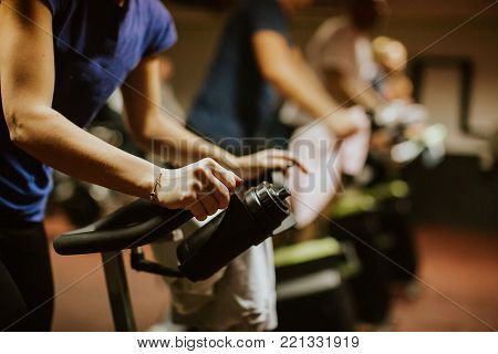 Cycling class indoors. Fat Burning Workout with cycling
