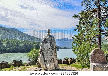 Turquoise Katun, Altai Republic, Russia - July 22, 2017: Marble monument to Nicholas Roerich - painter, philosopher-mystic, writer, traveler, on the picturesque bank of mountain river Katun