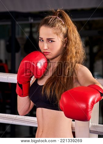Sport girl boxing wearing red gloves. Female resentment and anger with a thirst for revenge emotions concept.