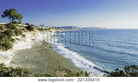 The coastline and landmark big white chalk rock at Governor's beach,