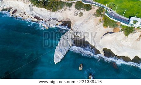 Aerial view of landmark big white chalk rock at Governor's beach