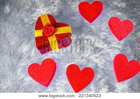 Heart Lined With Small Glass Hearts Laying On The Pillow Faux Fur Studded With Tiny Decorative Heart