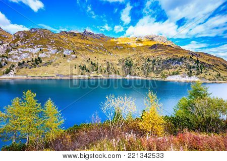The concept of ecological tourism. The harmony of the Dolomites. Mountain Lake Lago di Fedaia, Dolomites. Glacial lake with cold water