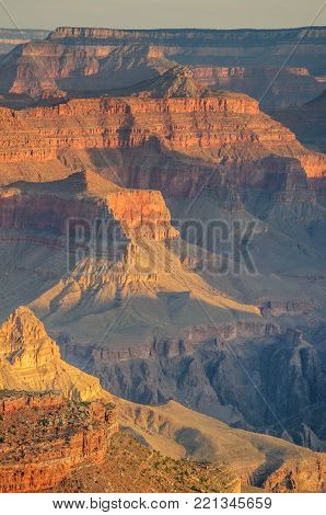 Sunrise Over The Grand Canyon, On An Early August Morning. The Rising Sun Is Casting Long Dramatic S