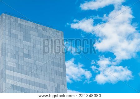 Sochi, Russia - March 31, 2016: Low angle view of a wall of the modern urban apartment building on the background of cloudy sky