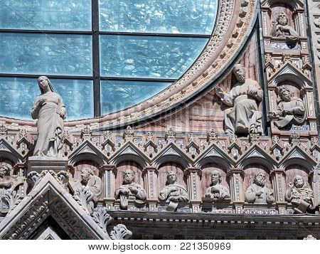 Detail of the upper facade of Siena cathedral with supltures of saint and philisophers