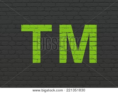 Law concept: Painted green Trademark icon on Black Brick wall background