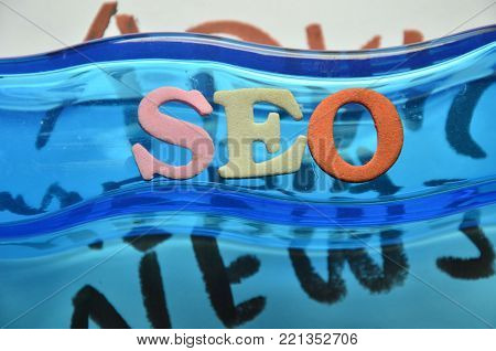 word seo on an   abstract colored background