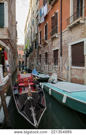 Beautiful photo of the Venetian canal with old houses , Italy .