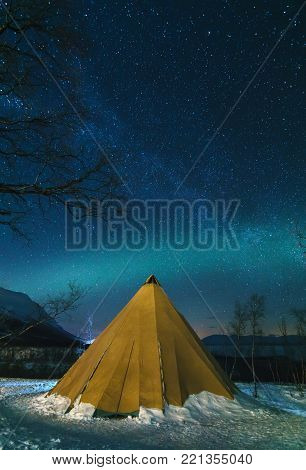 Eskimo Tent and Northern Lights with Milky Way in the National Park.