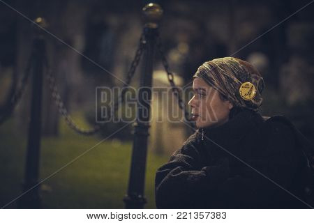 Bucharest, Romania - October 6, 2013: Portrait of a concerned young lady during the mass rally against the plan to open Europe's largest open-cast goldmine in Rosia Montana heritage site, Alba county.