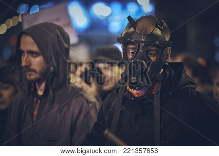 Bucharest, Romania - October 10, 2013: Protester wears gas mask during the uprising against the plan to open Europe's largest open-cast goldmine in the Rosia Montana.