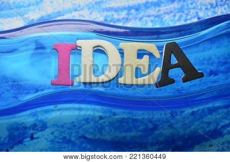 word idea on an  abstract colored background