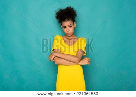 Sad african-american woman portrait. Lonely serious girl, blue studio background. Stress, depression, failure concept