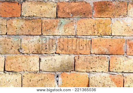 Orange brick wall facade of unfinished house or building