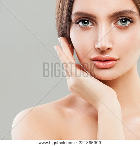 Perfect Female Face Closeup. Healthy Woman. Facial Treatment and Cosmetology Concept
