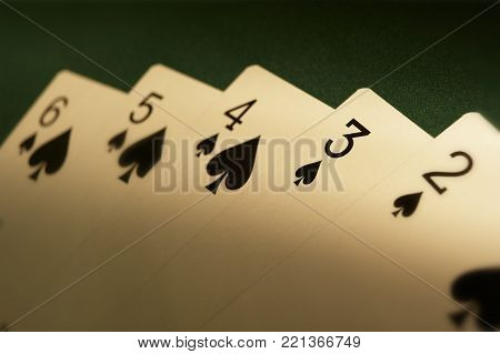 CLECKHEATON, WEST YORKSHIRE, UK: HAND OF PLAYING CARDS SHOWING FLUSH SIX FIVE FOUR THREE TWO ON GREEN CLOTH GAMING TABLE, CIRCA 2007, WEST YORKSHIRE, UK