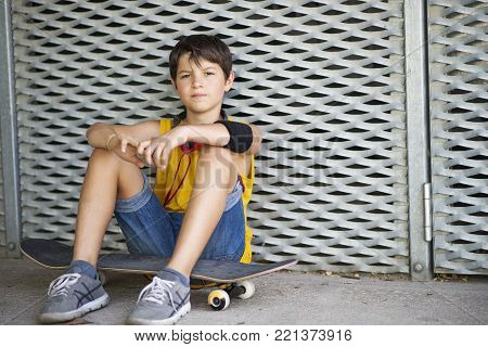 Casual Dressed Young Smiling Teen Skater Outdoors Portrait