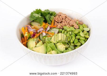 Buddha bowl of mixed vegetable with avocado and tuna fish