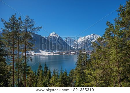 view from the lakeside road to famous tourist resort pertisau and lake achensee. austrian landscape at early springtime.