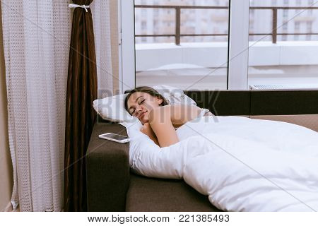 young girl is sleeping after dinner at home