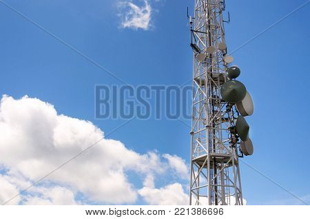 Transmitters and aerials on telecommunication tower, wireless communication concept