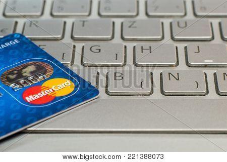 Sarajevo, Bosnia and Herzegovina - January 25 , 2017: closeup of credit card MasterCard. On laptop keyboard.