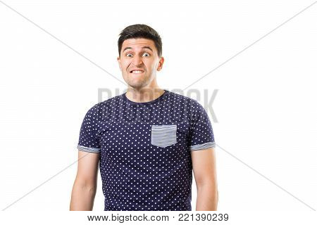 Young adult men with mad face expression biting his lips isolated on white background. Stress concept