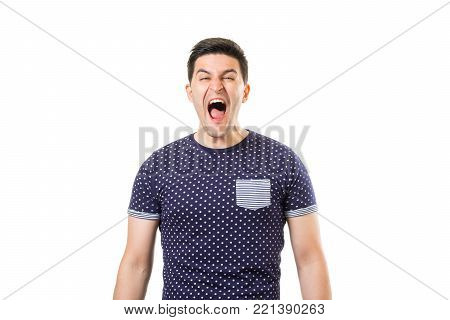 Young shouting men with aggressive expression on his face isolated on white background. Violence concept
