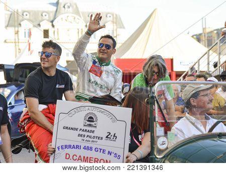 LE MANS, FRANCE - JUNE 16, 2017: Famous racer Duncan Cameron GBR and his team Aaron Scott GBR , M.Cioci. Ferrari racing team. Parade of pilots racing 24 hours Le mans
