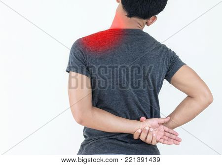 Young man feeling exhausted and suffering from shoulder pain, Health concept.