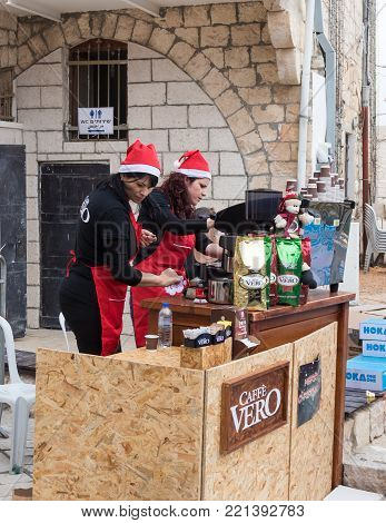 Mi'ilya, Israel, December 22, 2017 : Girls prepare coffee at the finish for participants of the annual race