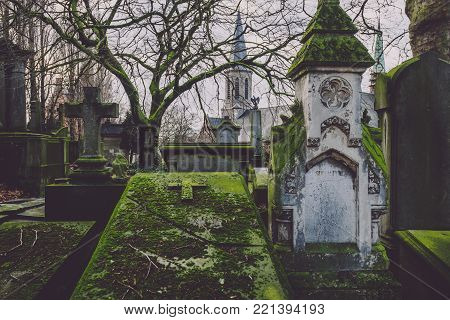 January 4th, 2017 - Ghent, East Flanders, Belgium. Saint Amandus chapel on Campo Santo historical cemetery in Sint-amandsberg municipality, Gent. Roman church, ancient tombs, graves and monuments.