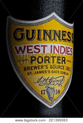LONDON, UK - JANUARY 02, 2018:  Bottle label of Guinness west indies porter beer on white background. Guinness beer has been produced since 1759 in Dublin, Ireland.
