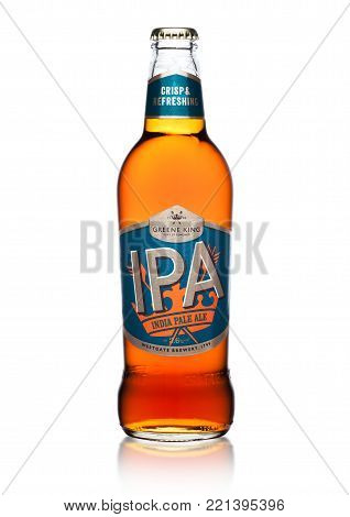 LONDON, UK - JANUARY 02, 2018: Cold bottle of IPA greene king india pale ale beer on white background.