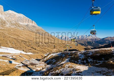 TRENTINO ITALY - DECEMBER 30, 2016: , A ski lift transports skiers at the Dolomites in winter on December 30, 2016