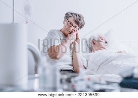 Loving Wife At Hospital Bed